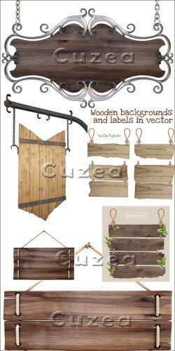 Деревянные фоны и таблички в векторе